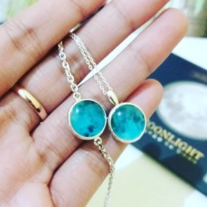 """waow, this is so cute a bluemoon necklace and bracelet from @wingbling_global. Glow-in-the-dark products shine normally in the dark when they're sufficiently charged with light. . If you want to get the product, you can visit my shop """"hicharis.net/titahin/bF8"""" . #clozette #clozetteid #charisceleb #hicharis #wingbling #glowmoon #bluemoon . @wingbling_global @charis_indonesia @charis_celeb @hicharis_official"""