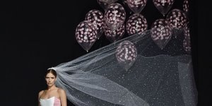Behold! The Most Extra Wedding Gown with Added Helium Balloons Just Took the Runway
