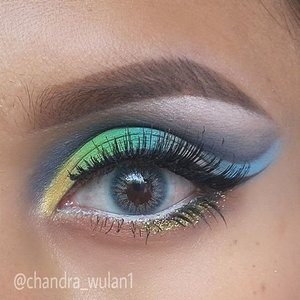 Colorful eye makeup. Inspired by @makeupbyan, but her version is muuuuch better than mine ... Products :Brows : @nyxmakeupid @nyxcosmetics eye brow gel - chocolateeyeshadows : coastal scentsLashes : @deyekoid - in da clubSoftlens : @kawaigankyu dubai tosca💚💛💜#cutcrease #colorfulcutcrease #peacock #anastasiabeverlyhills #fantasymakeup #makeupbyan #pangandaran #MuaPangandaran #makeupbyan #vegas_nay #maya_mia_y #mayamiamakeup #dressyourface #lookamillion #maryammaquillage #hudabeauty #neztheartist #zukreat #clozetteID #makeup #beauty #landofmakeup #theamazingworldofj #makeupbychristiaa #makeupwithammy #rfadai #wakeupandmakeup #universodamaquiagem_oficial #hudabeauty