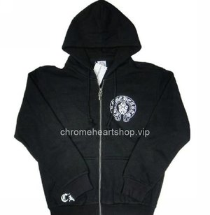 Chrome Hearts Amercial Flag Back Hoodie Black On Sale. Color: Black.  CH logo print at the front right side.  Chrome hearts round cross front. Back: Amoercia flag style logo.  Chrome Hearts Amercial Flag Back Hoodie Black Inspired by hip hop apparel, this zip-up hoodie from Chrome Hearts features luxurious details, making it an elegant off-duty option. With American flag and chrome hearts logo print at the back and samll horseshoe print on chest, this piece mixes high comfort with low-key style. Team it with a T-shirt and high top sneakers to take the look onto the city streets. Cotton. Imported.