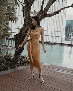 in the mood of mustard color, best choices dresses to wear even on party or chill with your besties 💕 i'm wearing lulu front tied dress from @rue_thelabel , and good news this babe also available at @dresshaus.id , download the apps for free only at apple's app store and shop on the go! #ruewomen