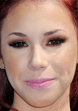 Jillian Rose Reed got a jarring contrast between the warm (and too heavy) brown eyeshadow and the cool-toned pink lips. And the false lashes are too much.
