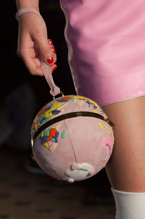 Season after season, Olympia Le Tan consistently creates the most charming of bags. She presented quite a few of her famous books-turned-clutches on the runway, but she also showed some more unusual but equally as cute evening bags, such as this pink globe.  Read more: http://stylecaster.com/best-bags-spring-2015/#ixzz3TZgVyTHl