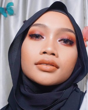 🥀..Make up deets:Face primer: @maybelline Baby Skin Instant Pore EraserFoundation: @maybelline Fit Me! Foundation (220) + @lorealindonesia Infallible Total Cover Foundation (309)Concealer: @maybelline Fit Me! Concealer (25)Powder: #Ponds BB Magic PowderBronzer: @catrice.cosmetics Sun Glow Matt Bronzing Powder (Medium Skin)Highlighter: @thebalmid Mary-Lou Manizer.Brows: @thefaceshop.official Designing Eyebrow Pencil (05 Dark Brown) + @etudehouseofficial Perfect Brow KitEyeshadow:- Focallure 18 Eyeshadow Palette - 02 Neutrals (bought from @ars_fashion)- @wardahbeauty Eyeshadow Trio - Seri GEyeliner: @mineralbotanica Precision Eyeliner Pen (Jet Black)Lashes: @loreca.lashes (Penelope).Lips: @ltpro_official Luminance Lipstick (Tangerine Twinkle)..#clozetteid #motd #beauty #hijab #beautyblogger #indobeautygram #tipscantik #tampilcantik #makeuplook #indonesiabeautyblogger #thebalmid #maybelline #lorealindonesia #ltpro #focallure  #lorecalashes