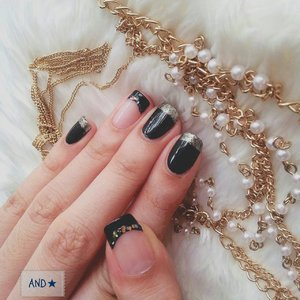 Simply black and gold nails