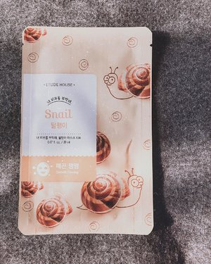 """(#maskoftheday) : Snail Sheet Mask from #EtudeHouse 🐌🐌🐌 >>> Although it may sounds like: """"ewww...snail slime?"""" - but snail secretion extracts are known for its many benefits for skin, including hydrating properties, smoothing and firming, as well as improving wrinkles and  fast healing of scars. . 🍂From my experience, I think this is a cooling mask. When I put this sheet mask on I experienced a slight sting on my problem areas (acne) but only for a few seconds. After that everything felt normal. There wasn't a lot of extra essence on the sheet so it's not dripping wet (which I love!). . 🐌The sheet is also easy to adjust on the face. I left it on for half hour and massage the extra essence left into my skin. There wasn't many essence left on the skin though, so I think the skin just absorbed the essence from the mask. And I think that's a good sign, meaning the skin can really benefit from all that essence. Afterwards, it made my skin supple, moist, and firm. It also helped calm down my acne too! 🧡 . . . . . . #sheetmask #sheetmaskaddict #sheetmaskkorea #sheetmaskreview #skincarelove #skincareblogger #skinessentials #etudehousemask #clozetteid #bloggerceria #indonesianbeautyblogger"""