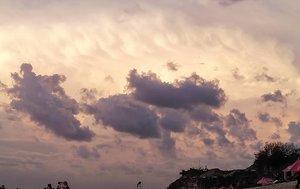 Today's sunset.Hari ini rame pantainya, ada wedding, ada foto-foto prewed (yes, full gown dress di pantai dengan deburan ombak), banyak yang selfie, bikin content, sampai minta foto sama bule cakep 🤣, namanya usaha ya bang, trus pulang kampung bilang itu pacar nya. _________#beauty #carnellinstyle #love #amazingview  #sunseabeach #Indonesia  #orangesky #photooftheday #photography #sunsetphotography #igtravel #sky  #clouds  #sunsetsky  #style #balibeach #ClozetteID#beach  #sunset  #travelwithCarnellin #colors  #bali
