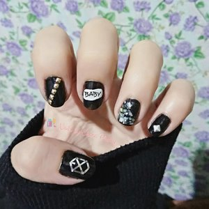 Call me baby.. 💅 #nailsbyeharapoetry . Not a fan, I just like the logo 😅 . #notd #exonail #nailsoftheday #exo #blacknails #nailart #realnails #nailpolishaddict #clozetteid #kukucantik #ネイルアート #爪 #マニキュア #かわいい