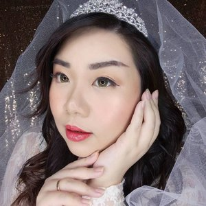 "I am super happy with how my Korean Bridal look turned out, even though i only spent 20 minutes on my makeup as it's actually super soft and simple - i did spent almost and hour struggling to curl my hair because i didn't want it to be straight as always. Must look special on your wedding somehow, no? Hahahaha.  Out of all the makeup collabs so far, i think i spent the most money for props of this one 😏 : 40k for the tiara, 20k for the veil (both are used for 2 looks already) and 35k for the bouquet - hahaha 95k is already considered a lot for this stingy woman 😛.  Ofc, everything is smoke and mirror, i was wearing my favorite duck patterned shorts underneath and my ""wedding dress"" is an old lace top from Forever 21 that my maid and searched high in low earlier because it was missing in my black hole of a dresser, but i already made up my mind to wear it for the look so thank God it showed up and i'd say i make the right decision 😛.  #makeuplook #weddingmakeup #koreanweddingmakeup #BeauteFemmeCommunity #SbyBeautyBlogger #clozetteid #startwithSBN #socobeautynetwork"