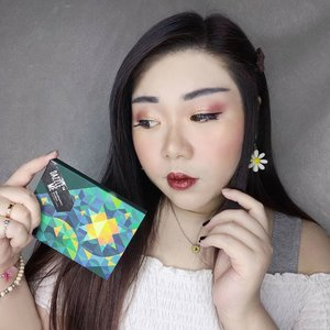 As I promised for quite a while now, review of @dazzleme.beauty.official Eyeshadow palette in Star/Mystery is here. After using it multiple times, I'm finally making up my mind about it 😁.  Color palette wise, I personally find this variant the most attractive out of the 3 variants available, if you love warm colors with sunset vibes - this one is for you. Containing 12 shades, ranging from matte, shimmer to glitter, the  size is pretty small and compact. The palette is made of sturdy cardboard material, making it travel friendly.  Texture wise, I find a lot of the shades to be very buttery and smooth, some bit harder and chalkier than others. Pigmentation is medium, nothing too impressive but nothing to be frustrated about. Some are a bit weak (some of  the shimmer shades are very weak and that really shocks me as usually the shimmers are a lot more pigmented in most palettes, on the contrary most of the darker matte shades are very nice. The glitter shade, Enigma, is beautiful and pigmented, probably my fave out of the palette) so you would need to apply a lot, but this also means that the palette is beginner friendly. All of the shades are blendable and I didn't find any to be patchy.  To be completely honest with you, my feelings for the palette? Just fine. I'm not blown away or anything, and if I have to pay the full price of the palette then I probably wouldn't - but they do go on promo all the time, and when they do, I think it's worth a try. I actually already purchased a second palette, would you like me to do a review and swatches of the second one as well? Please let me know coz I'd love to do it you are keen!  #dazzleme #dazzlemepalette #eyeshadow #eyeshadowpalette #reviewwithMindy #eyeshadowpalettereview #eyeshadowreview #chinesemakeup #clozetteid  #sbybeautyblogger #bloggerindonesia #bloggerceria #beautynesiamember #influencer #beautyinfluencer #surabayablogger #SurabayaBeautyBlogger #bbloggerid #beautybloggerid #indobeautysquad  #girl #asian #endorsem