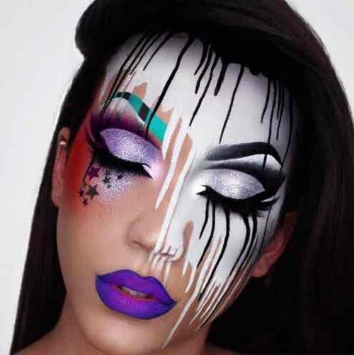 Makeup artist Luna has created a stunning showing of eye makeup art. When her eyes are closed each lid looks like a setting sun reflecting into the lake below.