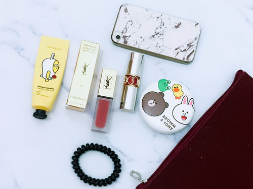 New Makeup Pouch from @bloggermafia 💕  Product i mention: *Red Blink Pouch @bloggermafia * Brown & Cony Mirror @bloggermafia *VOLUPTÉ TINT-IN-BALM #10SeduceMePink @yslbeauty *Lip Tatouage Couture Matte Stain #16NudeEmblem @yslbeauty *Kakao Friends HandCream #Muji #Rose @thefaceshop.official *Iphone 4S  #clozetteid #bloggermafia #bloggerjakarta #flatlay