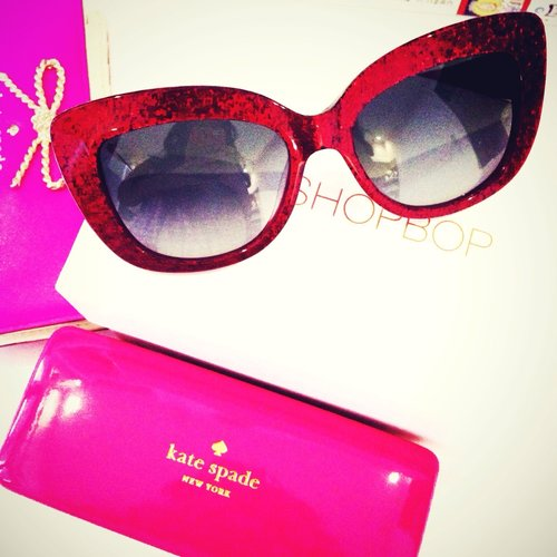 My new kate spade sunglasses from shopbop.com . Love the cat eye style and red glitters so much! I always think that red is the new black ;)