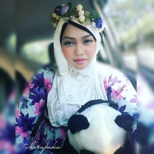 """Saturday, August 29th, 2015 ---- #MuslimahTraveler Day 4 : """"Mission Accomplish, Let's go home! """" 💑💍💐 💐💍💑 When I hug this #Panda from my brother and her fiancee, I feel like... my mission has been accomplished... alhamdulillah! 😉 Now it's time to go home and thinking about my own life lolz. My #OOTDis #fairy in #modestfashion #coveredstyle . I wear a simply #flowerpattern long dress, I bought this at Bringhardjo Market #Yogya... A simply white #instantheadscarf and my #handmade #flowercrown. Tattaraaaa!!... 🌸🌹🌻🌼#scarf #headscarf #traveling #trip #Indonesia #stylishtraveler #travelgrammer #ClozetteID"""
