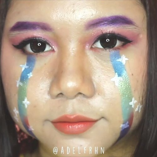 Crying Rainbow / Rainbow Tears Makeup Tutoral 🌈Inspired by @janineintansari 🌸Deets 🐾· @maybelline Baby Skin Pore Eraser· @youmakeups_id Full Coverage Liquid Foundation· @maybelline Instant Age Rewind Eraser Dark Circle· @fanbocosmetics Acne Solution Loose Powder· @beautyglazed Gorgeous Me· @holikaholika_indonesia Eye Spanglitter Color· @youmakeups_id Longlasting Ultra Waterproof Eyeliner· @catrice.cosmetics The Little Black One Mascara· @youmakeups_id Dual Extra Volume Mascara (only using the Fiber)· @eminacosmetics Cheeklit· @officialsnazaroo Sparkle Face Paint· @missha.official Wish Stone Tint Velvet#adelescence #grwdels @cchannel_beauty_id #cchannelbeautyid @cchannel_id #cchannelid #cchannelfellas @hyouyaa @ravenzii @kimuhazyo
