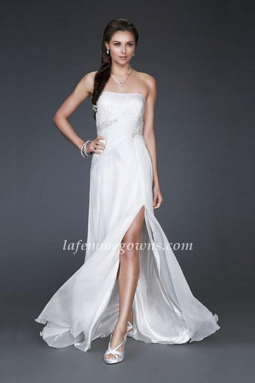 Feel like a princess in this graceful sweetheart Bridal by La Femme 16769 gown features a daring, asymmetrical low cut out to reveal a graceful back.  with exquisite diagonal beading at the waist and front slit.   Size: Standard Size or Custom Made Size Closure: Side Zipper Details: Front Slit, Ruched, Backless Fabric: Stretch Satin Length: Floor Length Neckline: Strapless Waist: Empire    Color: Ivory Tag: Ivory, Slit, Strapless, Long, Bridal Dresses, La Femme 16769