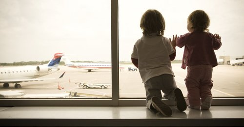Thinking About Flying With Kids? Here's What to Consider Before You Book That Flight
