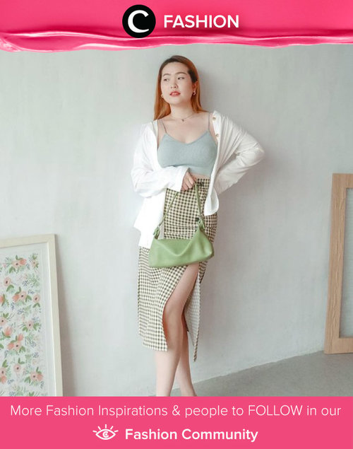 Slit skirt is always a good item to show your feminine figure. Steal Clozette Ambassador @reginabundiarti's style by pairing slit skirt with body hugging tank top and neutral cardigan. Simak Fashion Update ala clozetters lainnya hari ini di Fashion Community. Yuk, share outfit favorit kamu bersama Clozette.