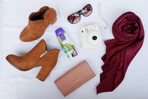 'Things you should bring when traveling' tante julit version : - Wallet full of cash, bank card, and ID - OOTD/HOTD style so you can still stay cyetaarrr (comfy shoes, neutral hijab, outer and inner, dress or jeans, choose whatever you want to wear and dont forget to mix and match) - Sunglass >> my fav stuff ever - Make up case (bawa seperlunya aja karena alis harus tetap paripurna) - camera (I couldn't agree more) - toiletries (I choose to pick my ready to go toiletries in mini pack, and after hours my hair tied tight covered with hijab, I need to refresh it with @sariayuhijab intense hair fall series,  no worries, stay catchy 😎 byeee hair fall 👋) . Lets pack my backpack and cant wait for my long holiday uyeaahhhhh 😙😙😙 #stuff #sunglass #camera #shampoo #shoes #hijab #hijabstuff #shampoohijab #fashion #style #blogger #beauty #beautyblogger #flatlays #lifestyle #travelstuff #traveler #backpacker #clozetteid