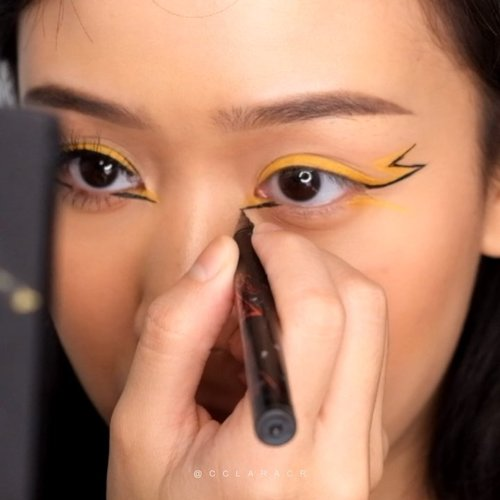 "Here is a mini tutorial how to achieve pikachu liner! 1. Use a yellow liner, im using from @colourpopcosmetics BFF LIQUID LINER ""make luv"" 2. Then using @maybelline #maybelline hypersharp liner (power black)3. Using concealer from @nyxcosmetics_indonesia CSWS shade ""natural"" with @sigmabeauty concealer brush no f704. Then accentuate the liners using @colourpopcosmetics BFF LIQUID LINER ""graceland"" #colourpopcosmetics5. Add a bit of blush and faux freckles using @minuet.official Tag me if you try this tutorial! Comment down below menurut kalian susah ga sihh? Selamat mencoba! 🤗😘😊...#indobeautygram #clozette #clozetteid #charisceleb #tampilcantik #inspirasicantikmu #ragamkecantikan #undiscovered_muas #make4glam #dailygirlsfeed #100daysmakeup #100daysofmakeupchallenge"
