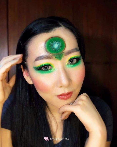 "Masih upload hasil Collab kemarin dengan salah satu Komunitas.Makeup Tema "" Fruit Makeup Look""aku ambil tema ""Kiwi"" karena menantang banget susah bikin warna kuning & ijo biar nyata banget..90% using Eyeshadow ❤️@beautyglazed ""Color Studio & Neptune"".Lipcream @focallurebeautyid Glitter - China Brand (ga tau merk apa) @handaiyan.cosmetics & @focallurebeautyid Awan2 itu sebagian @nyxcosmetics_indonesia jumbo pencil, sebagian pencil @silkygirl_id .Eyeliner @silkygirl_id Soflens @japansoftlens ""Lunatia Grey"".Complexion @revlonidEyebrow @lakmemakeup Eyelash @loreca.lashes ""Blossom""Brush @jacquelle_official @aerisbeaute @realtechniques_id.#artmakeup #makeupart #makeupoftheday #undiscoveredmuas #undiscovered_muas #beautybloggerindonesia #indobeautygram #indobeautysquad #tampilcantik #makeupideas #lemonsquad #100haringontenwithibc #artmakeupid @artmakeup_id #beautycreatorcommunity #clozetteid @clozetteid"