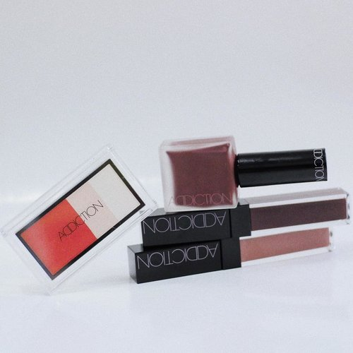 """Got myself some of @addictionbyayako Spring 2018 Forbidden Blush Collection and their new lipstick range Stolen Kiss with the help of my angel bff Elinda; mine are Empire Passion Blush Trinity, Forbidden City Cheek Polish, Double Suicide & Desert Rose Stolen Kiss lipsticks ♡•What intrigued me to have them are the unique shades & the names of these products. It's not everyday I see deep dark color on the blushes of Japanese beauty products. From what I've read on the official website of Addiction Beauty, Ms. Ayako is heavily inspired by the Tibetan women with their standout cheeks and the Spring 2018 Collections is all about vivid cheeks and lips, how fun! And the names! Aren't they like the coolest names ever???? Cool names and packagings are my weakness 😎Anyway some of these babies (except Desert Rose) may look scary and challenging on the first glance, but trust me, they look so pretty and natural once applied on skin.•I love Forbidden City Cheek Polish the most for its element of surprises. The texture & formula that similar to nail polish is very unique and is the first for me; it's watery and light but very easy to apply and to blend on skin. The other surprise is what looks scary and dark on the bottle translates sheer (but buildable!) yet so beautiful on the cheeks therefore it looks natural, it's like I'm blushing from the inside. Not to mention the name is super cool also. I'm head over heels in love ♡My second favorite is Double Suicide Stolen Kiss lipstick for its element of surprise too ♡ despite how scary dark it looks like on the bottle this matte lipstick is wearable, the berry shade is very lovely and brightens up my complexion. It has light & thin texture similar to lip tint, very different from the other matte lipsticks I've tried so far. It has medium coverage so you have to layer it up if you like a full coverage lipstick. It's matte but it feels pretty comfy on the lips, and long lasting. Now, if someone happen to ask me when I wear it, """"What li"""