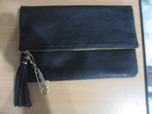 Black clutch from H&M, Bag charm from Guess