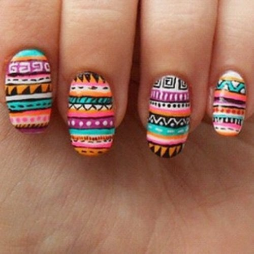 Tribal not just printed on shirt, but on nails will be better ^^