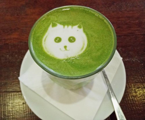 So cute... Too cute!  And obviously not mine. I'd die before i'd drink anything green tea 😨  Drink force-borrowed from @chelsheaflo 😛  #latte #latteart #greentea #greentealatte #caturra #caturraespresso #caturasurabaya #blogger #lifestyle #cafe #surabaya #surabayacafe #cafe #cafesurabaya #clozetteid #clozettedaily #lifestyleblogger #indonesianblogger #indonesianlifestyleblogger #surabayablogger #surabayalifestyleblogger #influencer #surabayainfluencer #influencersurabaya #instadrink #culinarydiary #coffee #coffeeaddict #coffeeislife
